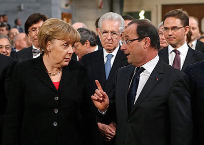 צרפת וגרמניה מתנגדות להצטרפות טורקיה לאיחוד. הולנד ומרקל (צילום: AP)