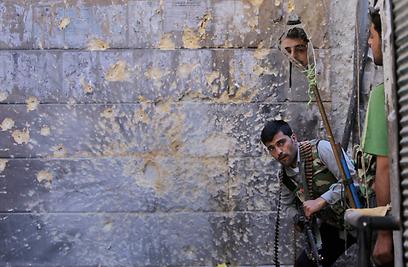 מורדים בחלב (צילום: AP)