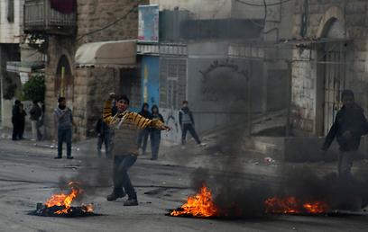 יום סוער בחברון  (צילום: AFP)