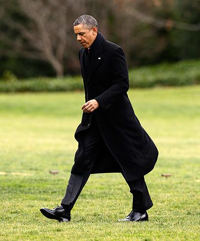אובמה עם שובו השבוע לבית הלבן (צילום:AP)
