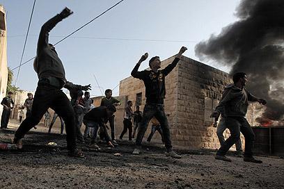 לא אינתיפאדה. הפגנת פלסטינים סמוך לג'נין (ארכיון) (צילום: AFP)