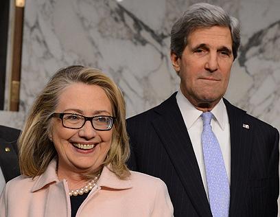 מתחלפים. קרי וקלינטון (צילום: AFP)