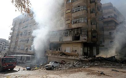 אחרי הפצצה של צבא סוריה נגד המורדים בדמשק (צילום: רויטרס)