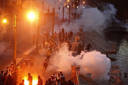 """הפגנה נגד מורסי בקהיר. """"הם בחרו בו"""" (צילום: רויטרס)"""