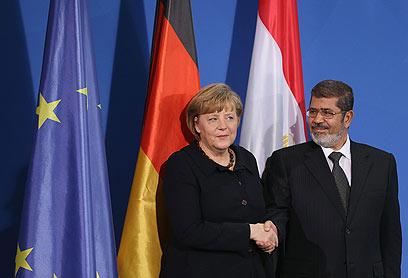 """מורסי בביקור בגרמניה. """"הוא מטייל"""" (צילום: Gettyimages)"""