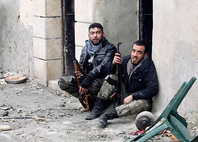 מורדים בסוריה. הלחימה נמשכת שנתיים (צילום: רויטרס)