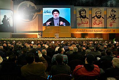 """נסראללה בהופעתו האחרונה בנאום משודר ב""""יום השאהיד"""" (צילום: AFP)"""