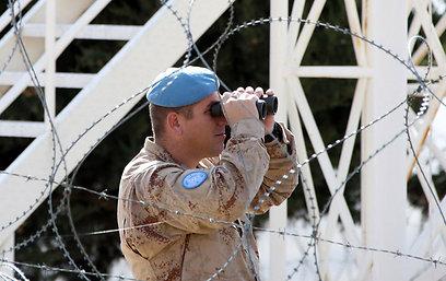 """כוח אונדו""""ף מוצב בגבול בין ישראל לסוריה ואוכף מ-1974 את הסכם הפסקת האש (צילום: AFP)"""