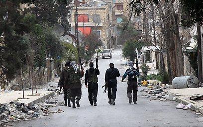 המורדים ברחובות חלב (צילום: MCT)