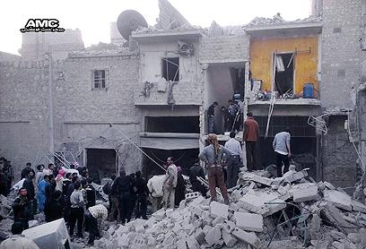 """הפצצה של צבא אסד בחלב. ארה""""ב זקוקה לשיתוף פעולה ישראלי-טורקי (צילום: AP)"""