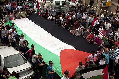 תהלוכת יום האדמה בסכנין (צילום: AFP)