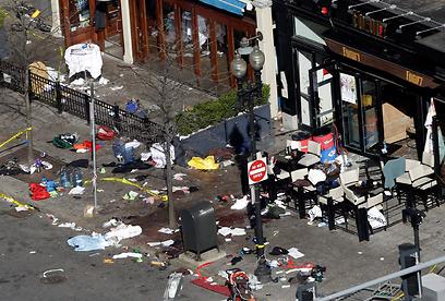 ההרס והדם אחרי הפיצוץ בבוסטון (צילום: AP)