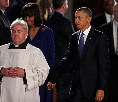 בני הזוג אובמה בטקס בקתדרלה בבוסטון (צילום: AP)