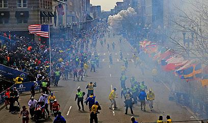 והתוצאה: שני הפיצוצים שזיעזעו את אמריקה (צילום: AP Photo/The Boston Globe, David L Ryan)