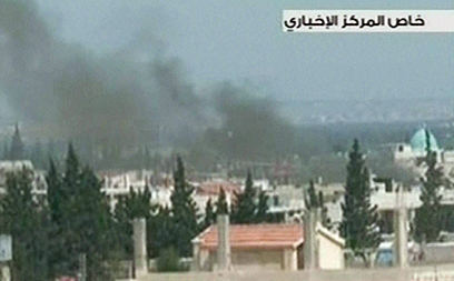 זירת הקרבות העיקרית. קוסייר (צילום: AFP,SYRIAN TV)