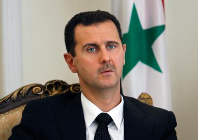 """נשיא סוריה אסד. הפעיל את """"יחידת הצבא הסורי האלקטרוני""""?  (צילום: AP)"""
