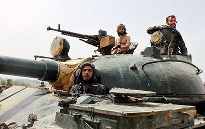 כיבוש קוסייר על ידי אסד יוביל להחלטת אובמה לספק נשק למורדים (צילום: רויטרס)