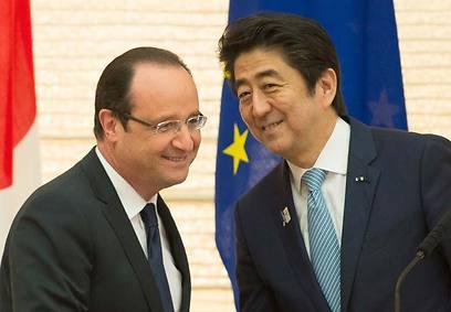 הולנד וראש ממשלת יפן (צילום: AFP)