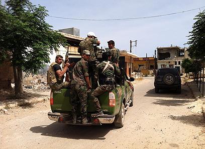 חיזבאללה במבוכה. לוחמים באל קוסייר  (צילום: AFP)