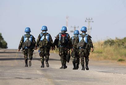 """פקחי או""""ם מאוסטריה עוזבים את רמת הגולן (צילום: AFP)"""