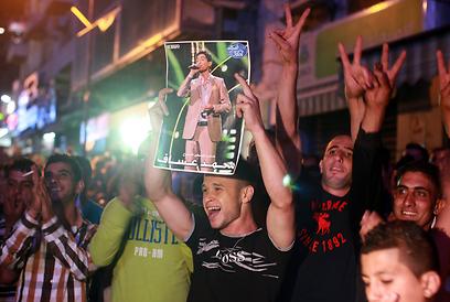 החגיגות שלפני הזכייה (צילום: AFP)