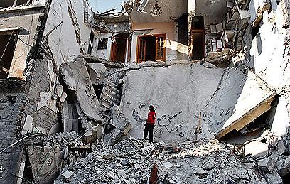 הרס בקרבות בעיר חומס (צילום: AP)