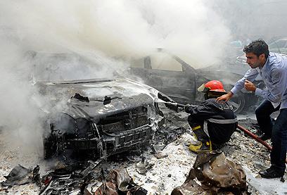 פיצוץ מכונית התופת בביירות אתמול. המורדים הסורים חשודים (צילום: EPA)