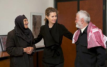 פגישת משפחות כוחות הביטחון עם רעיית הנשיא אסד (צילום: EPA)