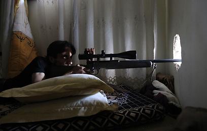 כוחות מורדים בחלב (צילום: רויטרס)