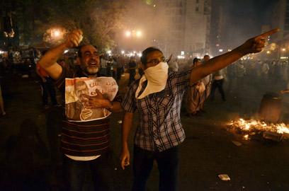 """מבעירים את קהיר. אנשי """"האחים המוסלמים"""" (צילום: AFP)"""