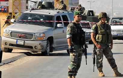 חיילים בזירה הפיצוץ, היום (צילום: רויטרס)