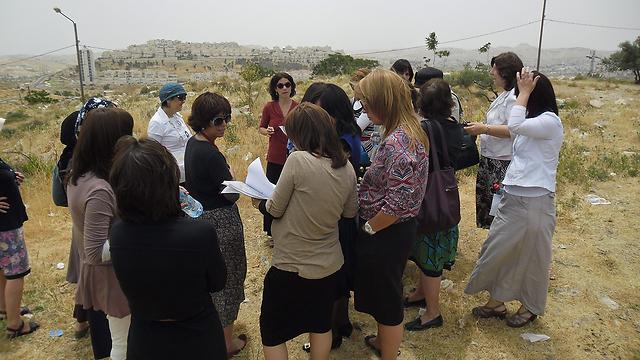 """נשות Interpeace. """"להכניס למו""""מ צדדים שחסרים בו"""" (צילום:  Interpeace UNDP)"""