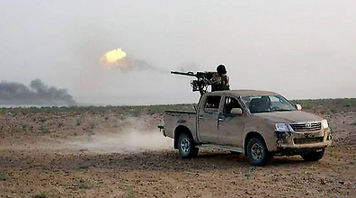 ISIS fighters drive in open trucks, an easy target for air raid (Photo: AP)