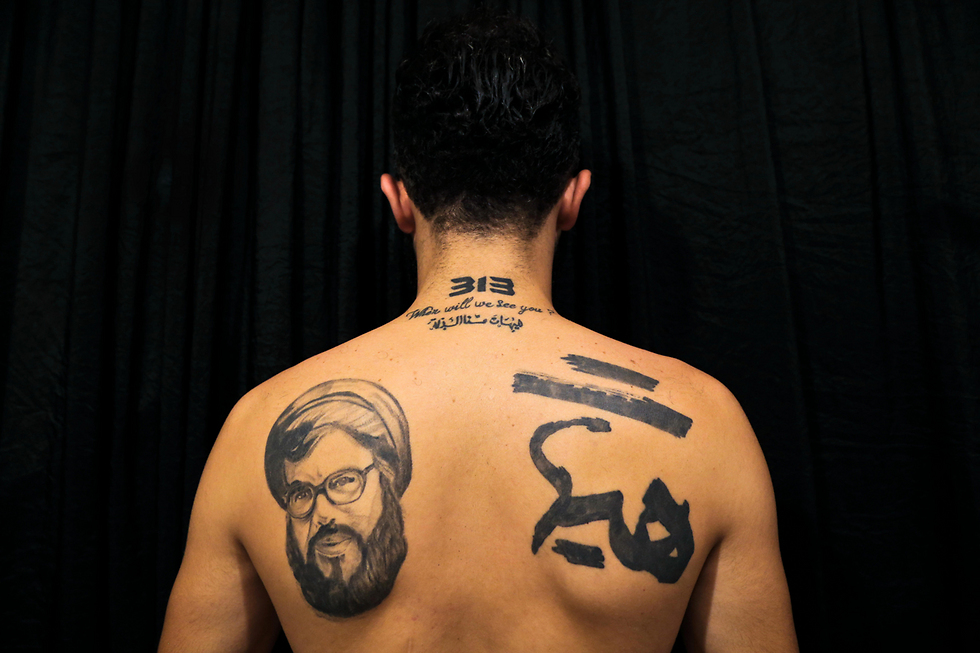 hezbollah supporters tattoo nasrallahs face on their chest. Black Bedroom Furniture Sets. Home Design Ideas