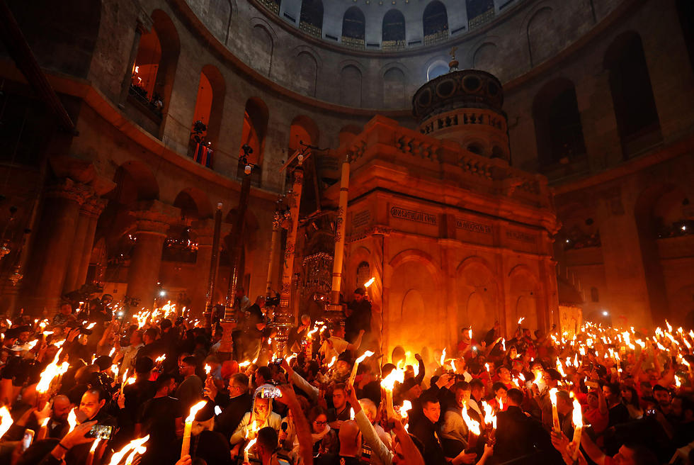 Worshippers Spread Holy Fire In Church Of Holy Sepulchre