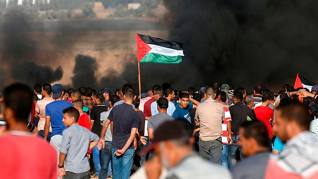 Palestinian killed in protests, IDF attacks Hamas outpost