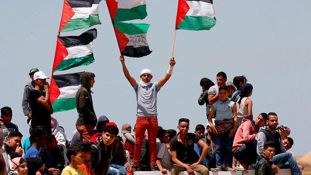Thousands gather at Gaza border fence as Palestinians mark Nakba Day